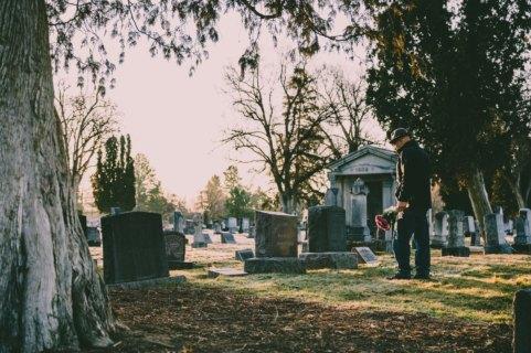 mourner in graveyard